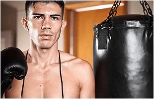 Man boxing on punching bag