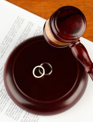 Gavel, couple ring and divorce paper