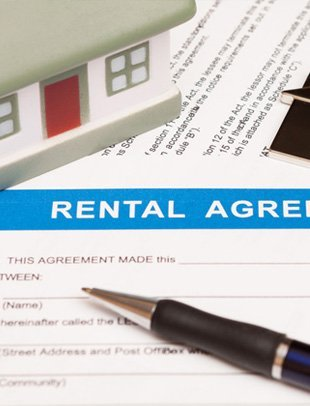 Rental agreement form paper and a pen