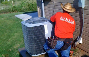 A man installing an airconditioning unit