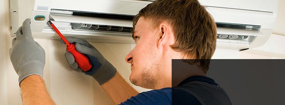 A man repairing an aircondition