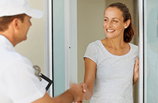 A woman shaking hands with an electrician