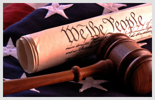 Wooden gavel and scrolled paper over american flag