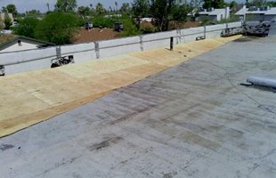 Repairing a commercial flat roof