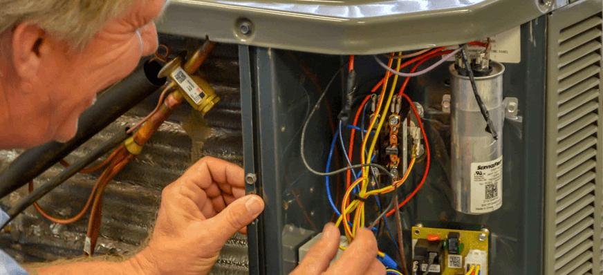 Technician fixing Heat pump