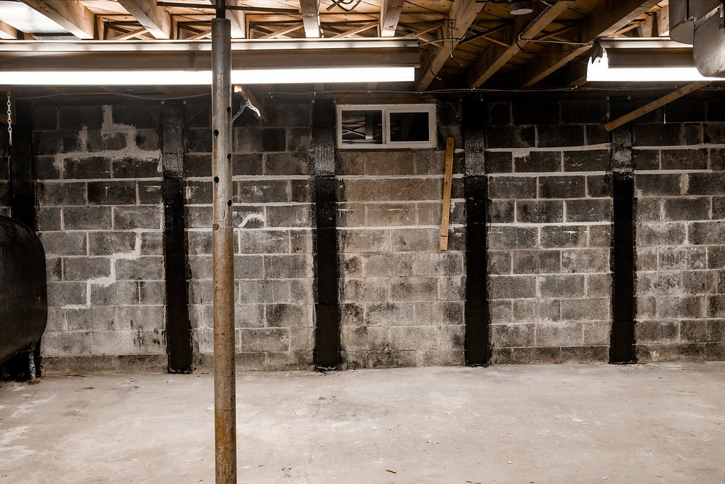 Bowed Concrete Cinder Block Wall Stabilization Repair
