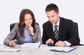 Men And Women Making Tax Preparation