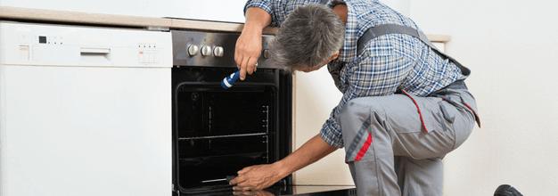 Service man repairing a stove