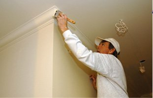 Painter painting the drywall