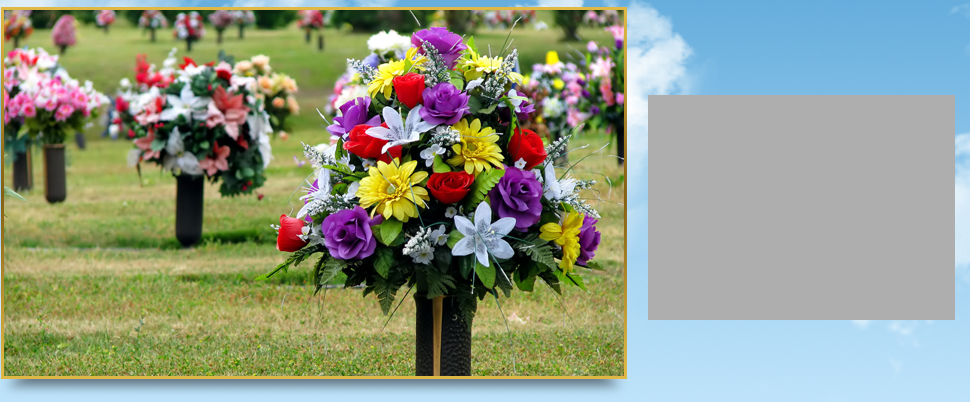 Flowers on a cemetery grave tombstone