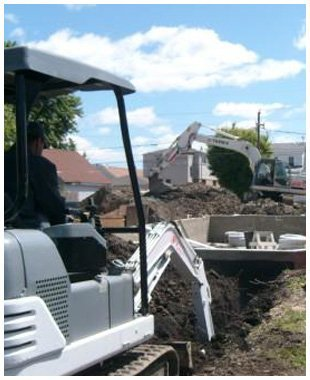 backhoe digging trench to replace pipe