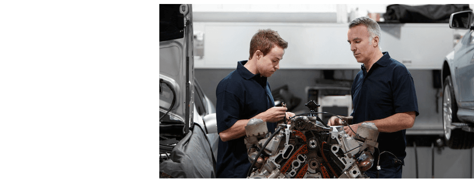 Engine being repaired by mechanics