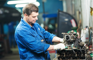 Engine being checked by a mechanic