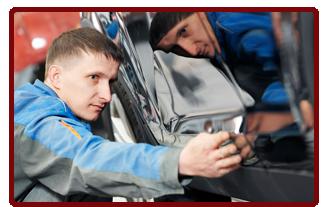 mechanic checking auto part