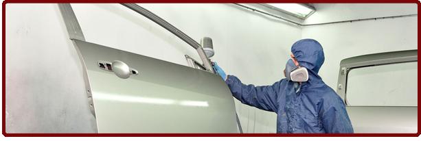 mechanic repainting auto