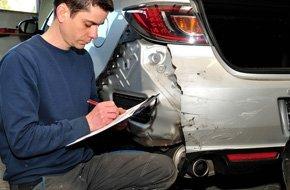 Man checking the damaged car