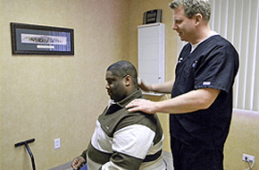 Therapist examining the patient