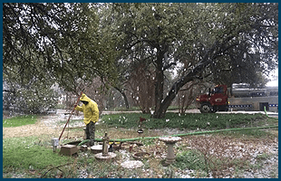 Man working on the septic hose | Septic service vehicle