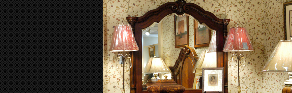 Beautiful mirror between the two lamp shades