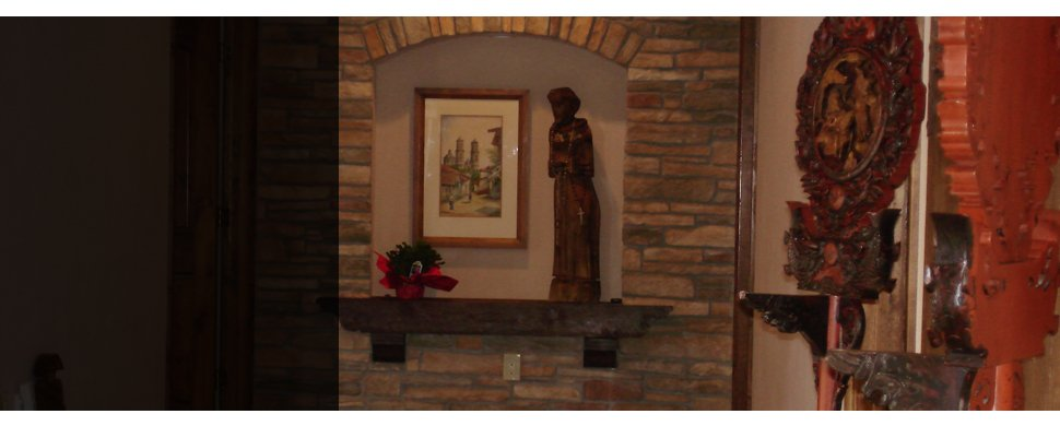 Brick wall with statue and picture frame