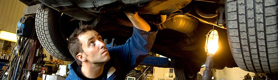 Garage mechanics working on engine
