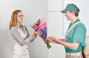 Man delevering the flower to women