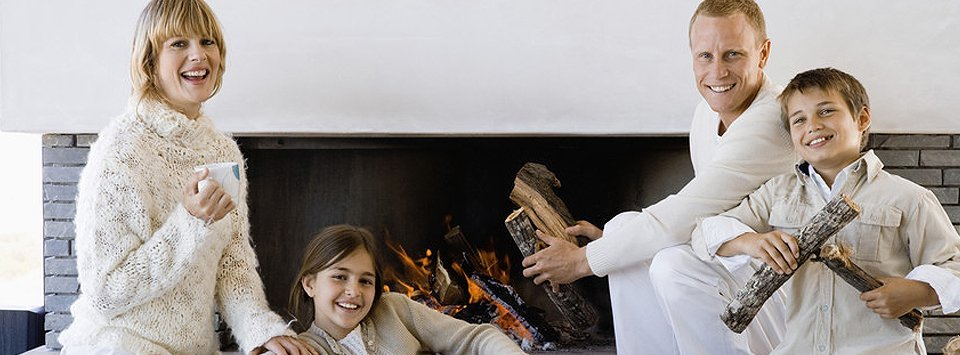 Happy family in front of fireplace