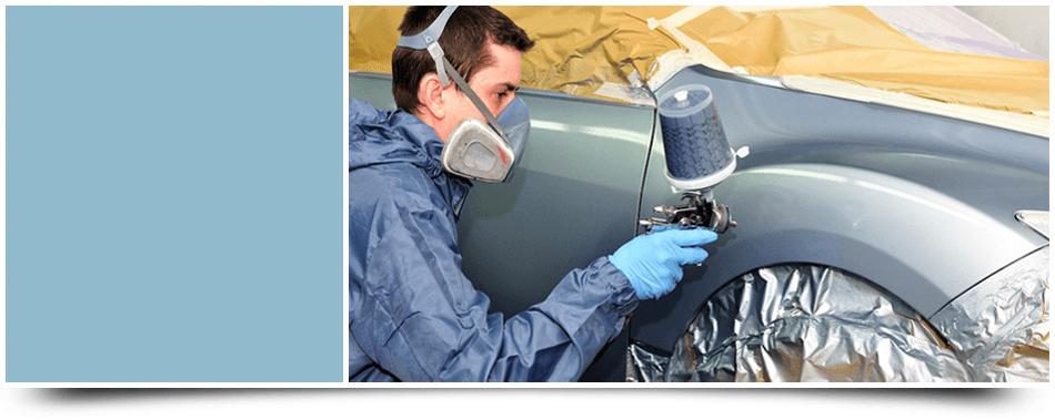 Man repainting a car