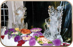 Wedding food table with ice sculptures