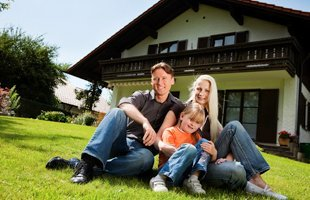 Family and house with insurance