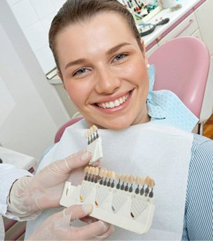 Woman being shown with partial dentures